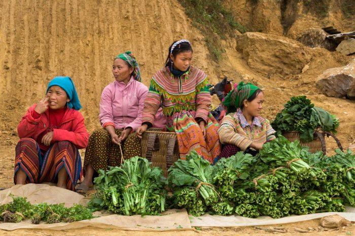 100-hmong-women-sell-vegetables-at-bac-ha-market,-vietnam-