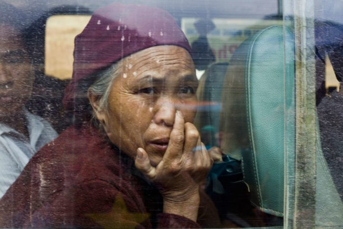 94-woman-crossing-the-china-vietnam-border-on-a-bus