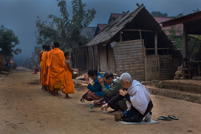 35-buddhist-monks-collecting-food,-laos