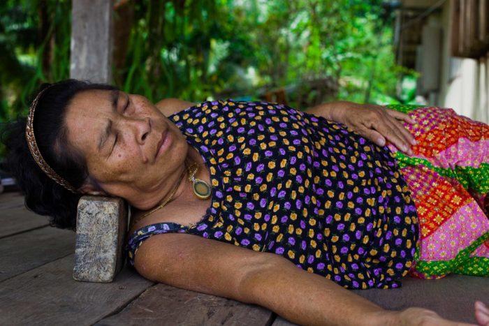 65-woman-napping-on-a-brick,-ko-chang-thailand-